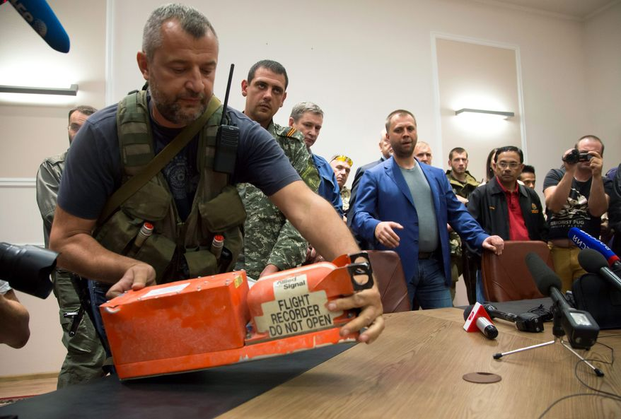 Crucial black boxes were handed over Monday night to Malaysian investigators trying to determine what happened when a jetliner was shot out of the sky over eastern Ukraine. Pro-Russia separatists had been limiting access to crash scene evidence.