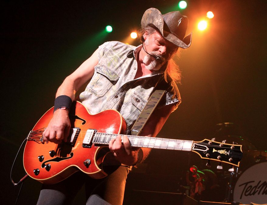 This Aug. 16, 2013, file photo shows Ted Nugent performing at Rams Head Live in Baltimore. (Photo by Owen Sweeney/Invision/AP, File)