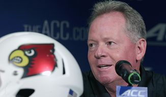 Louisville head coach Bobby Petrino answers a question during a news conference at the Atlantic Coast Conference Football kickoff in Greensboro, N.C., Monday, July 21, 2014. (AP Photo/Chuck Burton)
