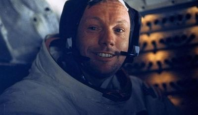 ** FILE ** In this July 20, 1969, file photo provided by NASA, astronaut Neil A. Armstrong, Apollo 11 commander, smiles for a photo inside the Lunar Module while it rested on the lunar surface. Armstrong was first out the lunar module, Eagle, onto the dusty surface of Tranquility Base. (AP Photo/NASA, File)