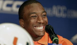Miami's Duke Johnson smiles as he answers a question during a news conference at the Atlantic Coast Conference Football kickoff in Greensboro, N.C., Sunday, July 20, 2014. (AP Photo/Chuck Burton)