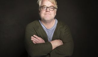 "FILE - In a Jan. 19, 2014 file photo Phillip Seymour Hoffman poses for a portrait at The GenArt Quaker Good Energy Lodge Powered by CEG, during the Sundance Film Festival in Park City, Utah.  Court documents filed July 18, 2014 show Hoffman rejected his accountant's suggestion he set aside money for his three children because he didn't want them to be ""trust fund"" kids. (Photo by Victoria Will/Invision/AP)"
