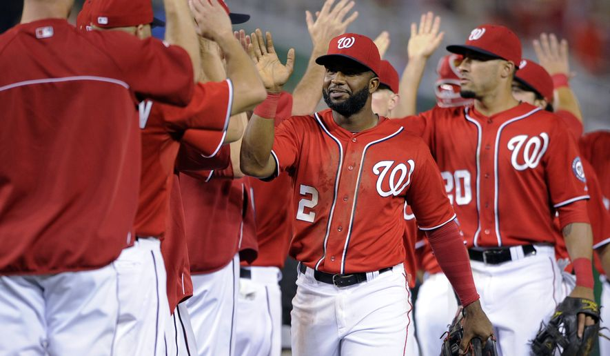 Washington Nationals' Denard Span (2), Ian Desmond (20) and others celebrate an 8-3 win over the Milwaukee Brewers in a baseball game, Saturday, July 19, 2014, in Washington. (AP Photo/Nick Wass)