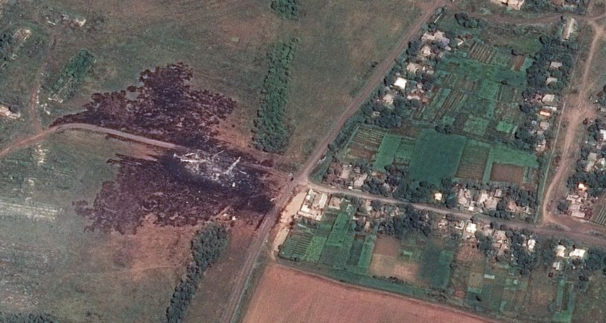 In this photo provided and dated Sunday, July 20, 2014 by Airbus DS/AllSource Analysis, a satellite image shows the primary crash site, at left, of Malaysia Airlines Flight 17 located near Hrabove, eastern Ukraine. Four days after Flight 17 was shot out of the sky, international investigators still have had only limited access to the crash site, hindered by the pro-Russia fighters who control the verdant territory in eastern Ukraine. (AP Photo/Airbus DS/AllSource Analysis) MANDATORY CREDIT