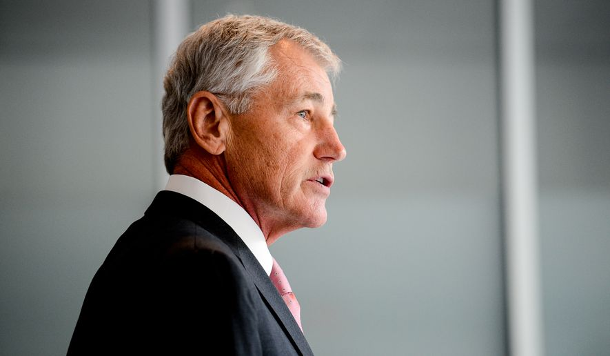 United States Secretary of Defense Chuck Hagel speaks with members of the media briefly after signing the register of condolences for the victims of Malaysian Airlines flight MH17 at the Netherlands Embassy, Washington, D.C., Monday, July 21, 2014. The international flight from Amsterdam to Kuala Lumpur crashed in Ukraine after it is believed to have been shot down. (Andrew Harnik/The Washington Times)