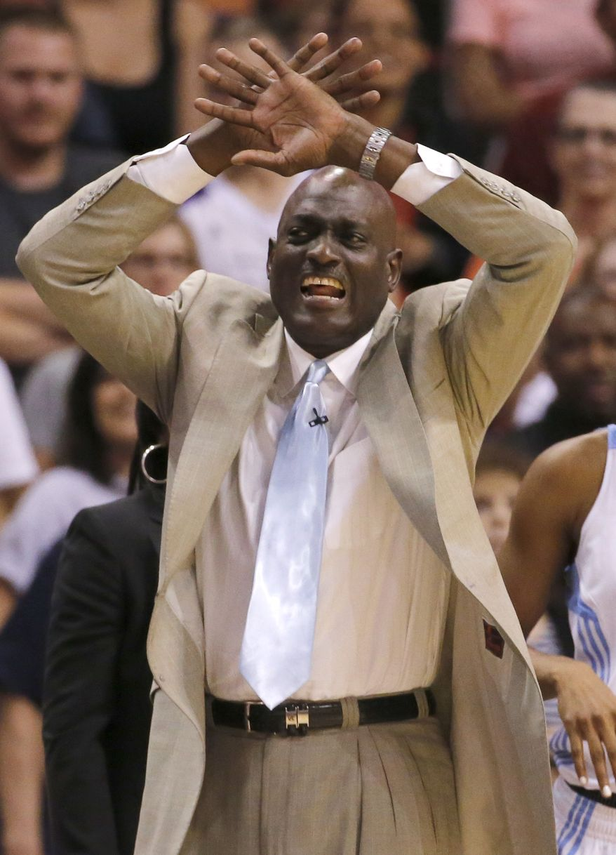 East head coach Michel Cooper, of the Atlanta Dream, yells to his team during the first half of the WNBA All-Star basketball game, Saturday, July 19, 2014, in Phoenix. The East won 125-124 in overtime. (AP Photo/Matt York)