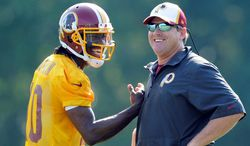 Redskins quarterback Robert Griffin III and first-year coach Jay Gruden seem perfect for each other at this stage in their careers. But many thought Griffin and former coach Mike Shanahan were in it for the long haul as well. (Associated Press)