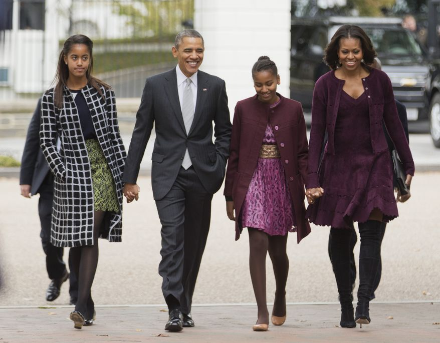 **FILE** President Obama, first lady Michelle Obama and their daughters Malia (left) and Sasha walk from the White House in Washington to attend a church service on Oct. 27, 2013. (Associated Press)