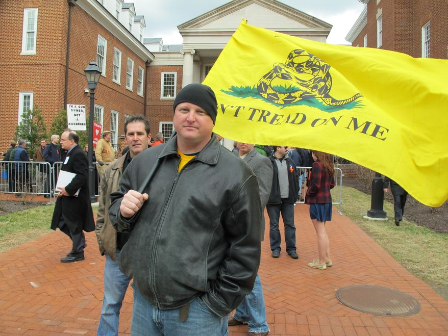 Doug Bigelow, of Hagerstown, Md., expresses his support for the right to bear arms on March 1, 2013, in Annapolis, where a gun-control measure that would ban assault weapons had a hearing. (Associated Press) ** FILE **