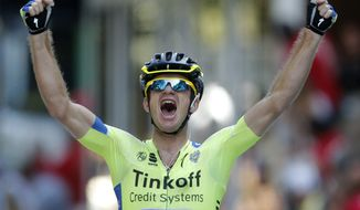 Australia's Michael Rogers crosses the finish line to win the sixteenth stage of the Tour de France cycling race over 237.5 kilometers (147.6 miles) with start in Carcassonne and finish in Bagneres-de-Luchon, France, Tuesday, July 22, 2014. (AP Photo/Peter Dejong)