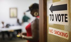 A sign directs voters at a polling site, Tuesday, July 22, 2014, in Atlanta. Voters head to the polls on Tuesday to decide the U.S. Senate GOP runoff between Jack Kingston and David Perdue. The winner will face Democrat Michelle Nunn in November. In addition to the high-profile GOP U.S. Senate runoff, voters in Georgia on Tuesday will cast ballots in a number of other races, including four U.S. House runoffs and state school superintendent. (AP Photo)