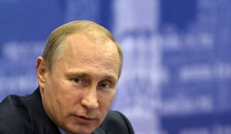 """Russian President Vladimir Putin listens during a meeting in Samara, Russia, Monday, July 21, 2014. Putin has lambasted those who use the downing of a passenger jet in eastern Ukraine for """"mercenary objectives,"""" the Kremlin said Monday. In a statement posted on the Kremlin website, Putin again lashed out at Ukraine for ongoing violence with pro-Russian rebels in the eastern part of the country. (AP Photo/RIA-Novosti, Alexei Nikolsky, Presidential Press Service)"""