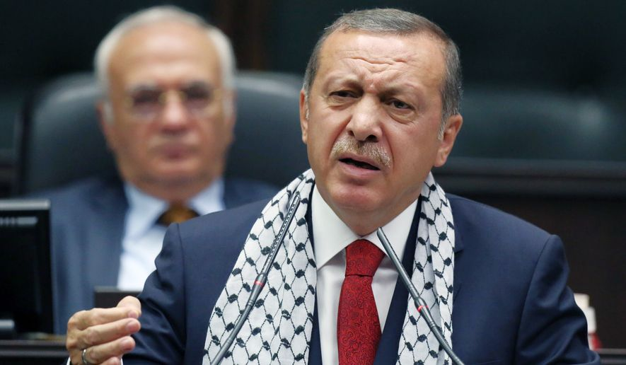 ** FILE ** Turkish Prime Minister Recep Tayyip Erdogan addresses his supporters at parliament in Ankara, Turkey, Tuesday, July 22, 2014. (AP Photo/Burhan Ozbilici)