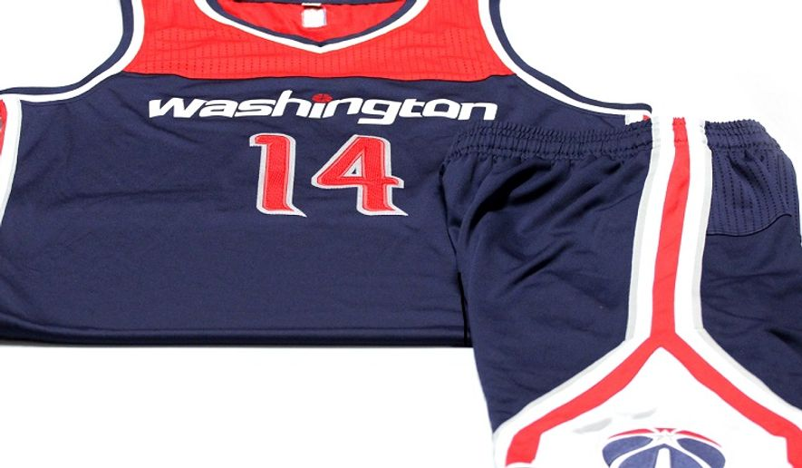 """The Washington Wizards unveiled new alternate uniforms for the 2014-15 NBA season, including shorts featuring the team's """"monument"""" logo. (Washington Wizards photo)"""