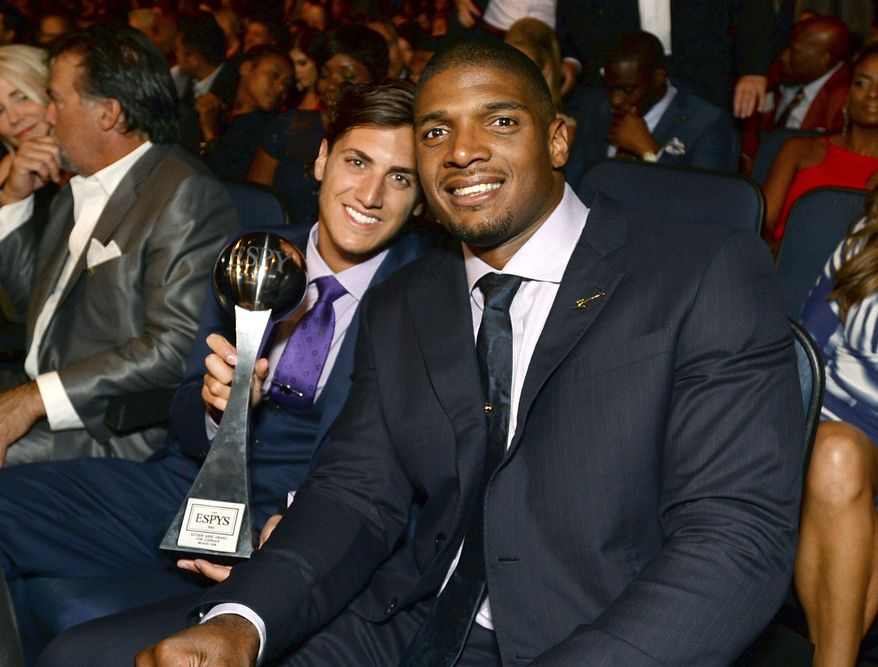 Vito Cammisano, left, and Michael Sam pose in the audience at the ESPY Awards at the Nokia Theatre on Wednesday, July 16, 2014, in Los Angeles. (Photo by Jordan Strauss/Invision/AP)