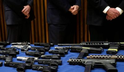 """Guns are the problem and access to guns are the problem,"" said Robert Sanders, a former assistant director of the federal Bureau of Alcohol, Tobacco, Firearms and Explosives. He said a policy shift in the Justice Department under Attorney General Eric H. Holder Jr. has downgraded the pursuit of criminals with guns as a priority. (Associated Press photographs)"