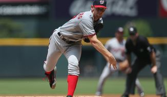 Washington Nationals starting pitcher Stephen Strasburg works against the Colorado Rockies in the first inning of a baseball game in Denver on Wednesday, July 23, 2014. (AP Photo)