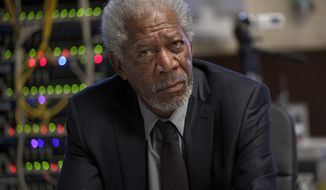"This image released by Universal Pictures shows Morgan Freeman in a scene from ""Lucy."" (AP Photo/Universal Pictures, Jessica Forde)"
