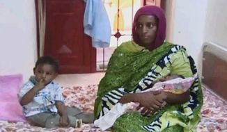 Meriam Ibrahim in her room in a Khartoum prison with her 18-month-old son Martin and her baby girl that she gave birth to in jail. Her initial death sentence for aposty was cancelled, but while trying to come to the U.S. with her husband, an American, she was arrested again. (Associated Press)