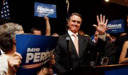 """After winning Tuesday's Republican primary , businessman David Perdue immediately turned his focus to his Democratic rival Michelle Nunn, painting her as an Obama ally and saying she has to """"defend the failed policies of the last six years."""" (Associated Press Photographs)"""