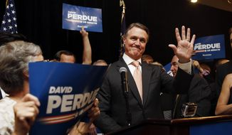 David Perdue waves to supporters after declaring victory in the Republican primary runoff for nomination to the U.S. Senate from Georgia, at his election-night party in Atlanta, Tuesday, July 22, 2014. Perdue defeated Rep. Jack Kingston. (AP Photo)