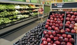 **FILE** A woman shops for produce at a Wal-Mart in Maumelle, Ark., on April 29, 2008. (Associated Press)