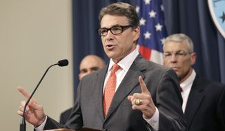 This July 21, 2014, file photo shows Gov. Rick Perry as he speaks during a news conference in the governor's press room, in Austin, Texas. (AP Photo/Eric Gay, File)
