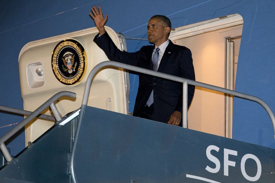 ** FILE ** President Barack Obama arrives in San Francisco, Tuesday, July 22, 2014, to continue a three-day West Coast trip that is planned to include at least five fundraising events in Seattle, San Francisco and Los Angeles. (AP Photo)