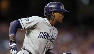 San Diego Padres' Cameron Maybin runs out a ground rule RBI double against the Colorado Rockies during the sixth inning of an MLB baseball game on Monday, July 7, 2014, in Denver (AP Photo/Jack Dempsey)