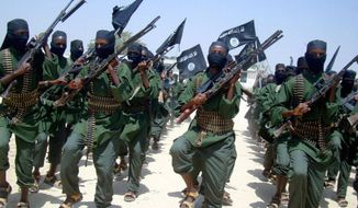** FILE ** Al-Shabab fighters march with their weapons during military exercises on the outskirts of Mogadishu, Somalia, Feb. 11, 2011. (Associated Press)