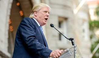 Donald J. Trump speaks before participating in a groundbreaking ceremony for the Trump International Hotel, a $200 million redevelopment of the iconic Old Post Office building on Pennsylvania Ave., Washington, D.C., Wednesday, July 23, 2014. (Andrew Harnik/The Washington Times)