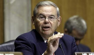 FILE - In this July 17, 2014, file photo,. Senate Foreign Relations Chairman Robert Menendez, D-N.J., gestures as she speaks on Capitol Hill in Washington. Menendez threatened Thursday, July 24, to block U.S. arms sales to Iraq if Congress doesn't get an assessment of Iraqi forces and assurances the weapons won't fall into the hands of extremist militants.(AP Photo/J. Scott Applewhite, File)