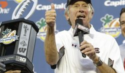 FILE - This Jan. 1, 2014 file photo shows South Carolina head coach Steve Spurrier thanking fans for their support after winning 34-24 in the Capital One Bowl NCAA college football game against Wisconsin in Orlando, Fla. Spurrier starts his 10th season with the Gamecocks with higher expectations than ever before. His team was picked to win the Southeastern Conference Eastern Division and the cagey Spurrier thinks it might be his best chance to claim another league crown. (AP Photo/John Raoux, File)