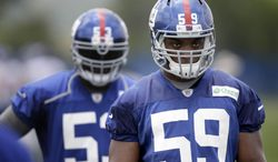 New York Giants' Devon Kennard practices during a NFL football camp in East Rutherford, N.J., Wednesday, July 23, 2014. (AP Photo/Seth Wenig)