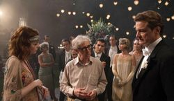 "This image released by Sony Pictures Classics shows director Woody Allen, center, with actors Emma Stone, left, and Colin Firth on the set of ""Magic in the Moonlight."" (AP Photo/Sony Pictures Classics, Jack English)"