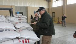 Special Inspector General for Afghanistan Reconstruction John F. Sopko inspects soybeans in Mazar-e Sharif. Afghan farmers produced negligible amounts of soy, and the sustainability of the major soybean processing facility is in serious doubt because there is not enough product for the facility to be economically viable. Some soybeans have had to be shipped in by the U.S.