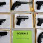 Chicago police display some of the nearly 3,400 illegal firearms confiscated so far this year in their battle against gun violence in the Windy City. (Associated Press photographs)