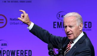 Vice President Joe Biden gestures as he speaks at the National Urban League Conference at the Duke Energy Center, Thursday, July 24, 2014, in Cincinnati. (AP Photo/The Cincinnati Enquirer, Cara Owsley)  MANDATORY CREDIT;  NO SALES