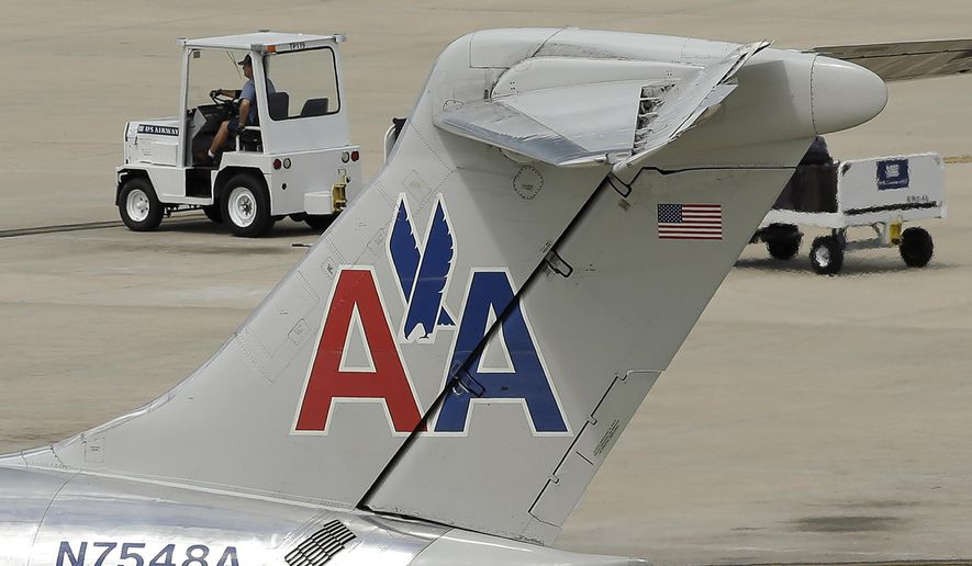 A ramp worker rolls past an American Airlines McDonnell Douglas MD-82 at the Tampa International Airport in Tampa , Fla., on May 15. (Associated Press)