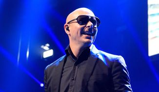 This Dec. 4, 2013, file photo shows Pitbull performing in concert during the Q102 Jingle Ball at the Wells Fargo Center in Philadelphia. (Photo by Owen Sweeney/Invision/AP, File)