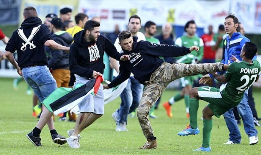A pre-season friendly between Israeli soccer team Maccabi Haifa and France's Lille was brought to an abrupt end in Austria on Wednesday when a group of protesters waving Palestinian flags stormed the field and began attacking Israeli players. (Twitter/The Daily Mail)