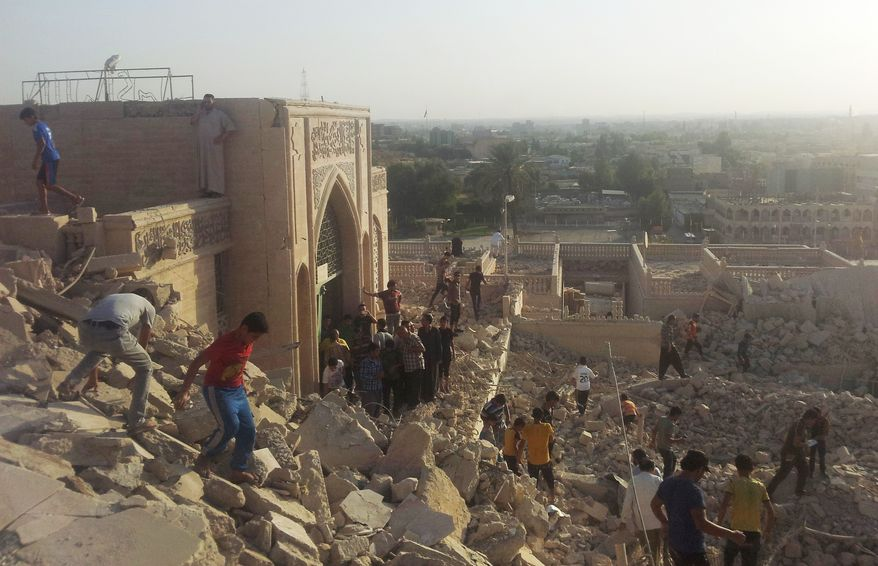 People walk on the rubble of the destroyed Mosque of The Prophet Younis, or Jonah, in Mosul, 225 miles (360 kilometers) northwest of Baghdad, Iraq, Thursday, July 24, 2014. The revered Muslim shrine was destroyed on Thursday by militants who overran the city in June and imposed their harsh interpretation of Islamic law. The mosque was built on an archaeological site dating back to 8th century BC, and is said to be the burial place of the prophet, who in stories from both the Bible and Koran is swallowed by a whale. (AP Photo)