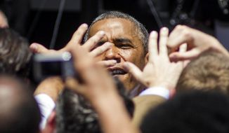President Barack Obama greets with supporters at Los Angeles Trade-Technical College in Los Angeles on Thursday, July 24, 2014.  (AP Photo/Ringo H.W. Chiu)