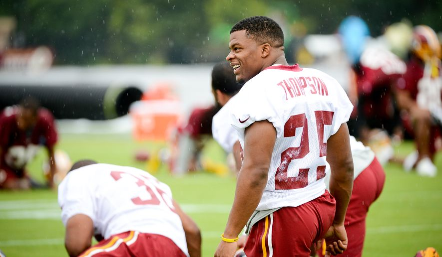 Washington Redskins running back Chris Thompson (25) stretches on the opening day of Washington Redskins Training Camp at Bon Secours Training Center, Richmond, Va., Thursday, July 24, 2014. (Andrew Harnik/The Washington Times)