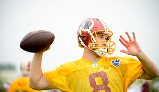 Washington Redskins quarterback Kirk Cousins (8) warms up on the opening day of Washington Redskins Training Camp at Bon Secours Training Center, Richmond, Va., Thursday, July 24, 2014. (Andrew Harnik/The Washington Times)