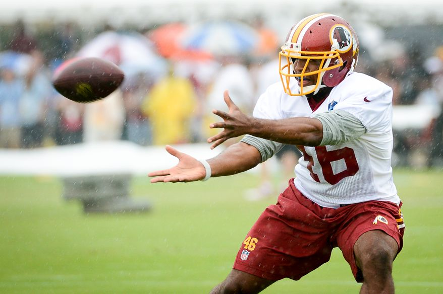 Washington Redskins running back Alfred Morris (46) catches a ball on the opening day of Washington Redskins Training Camp at Bon Secours Training Center, Richmond, Va., Thursday, July 24, 2014. (Andrew Harnik/The Washington Times)