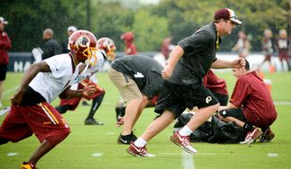 Washington Redskins head coach Jay Gruden runs a route along with Washington Redskins wide receiver DeSean Jackson (1), left, on the opening day of Washington Redskins Training Camp at Bon Secours Training Center, Richmond, Va., Thursday, July 24, 2014. (Andrew Harnik/The Washington Times)