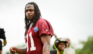 Washington Redskins strong safety Brandon Meriweather (31) walks off the field following morning practice on the opening day of Washington Redskins Training Camp at Bon Secours Training Center, Richmond, Va., Thursday, July 24, 2014. (Andrew Harnik/The Washington Times)