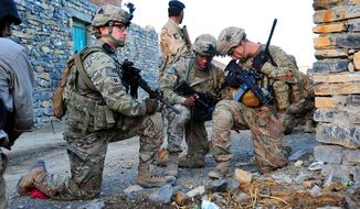 Capt. Lou Cascino, commander of Easy Company, 2nd Battalion, 506th Infantry Regiment, 4th Brigade Combat Team, 101st Airborne Division (Air Assault), pulls security while Staff Sgt. Eric Stephens and 1st Lt. James Kromhout verify their position during a partnered patrol in Madi Khel, Khowst Province, Afghanistan, Oct. 20, 2013. (U.S. Army photo)