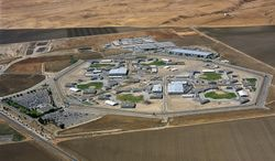 This undated photo released by the Avenal State Prison public information office shows an aerial view of Avenal State Prison in Avenal, Calif. Federal experts are recommending that California test inmates for immunity to a sometimes fatal soil-borne fungus before incarcerating them at two Central Valley state prisons, Avenal and Pleasant Valley, where the disease has killed nearly three dozen inmates, according to a report obtained Friday, July 25, 2014, by The Associated Press. (AP Photo/Avenal State Prison Public Information Office)